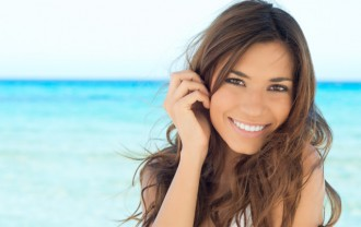 Young Woman Enjoying On Beach